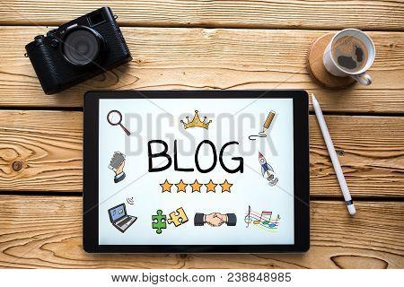Blog Concept On Digital Tablet In Home Office On Wooden Desk