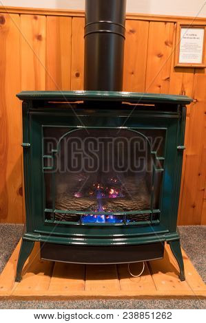 Bedroom Heating From A Propane Fireplace Made To Look Like An Antique Wood Stove.