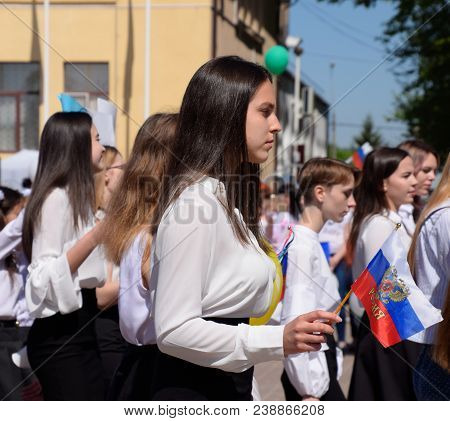 Slavyansk-on-kuban, Russia - May 1, 2018: Girl With The Flag Of Russia. Celebrating The First Of May