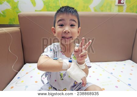Admitted Sick Kid Patient Victory Symbol On Saline Bandage Hand Feel Happy At Hospital With Medical