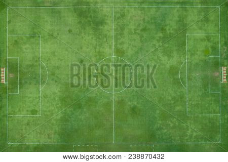 Outdoor Football Or Futsal Stadium. Made By And Green Grass. View From Fly Drone