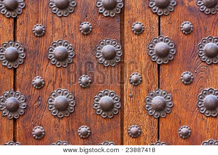 Iron Flower Pattern Over Wooden Door