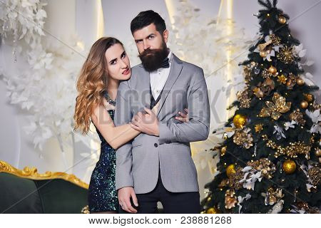 A Loving Couple Enjoy Each Other Is Celebrating Christmas Holiday. Handsome Man And Beautiful Woman