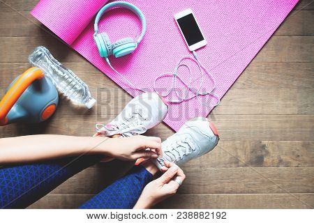 Sport And Healthy Woman Tying Her Shoes, Workout At Home, Wellbeing