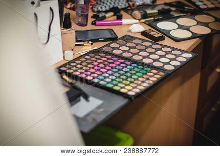 Colorful Eyeshadow Palette. Set Of Multicolored Eye Shadow. Work Desk Of Makeup Artist In The Studio