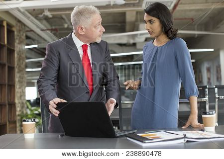 Young Female Professional Talking To Experienced Coach After Seminar. Mid Adult Man With Laptop Expl