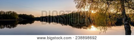French Landscape - Lorraine. Panorama Of A Small Lake With Trees In The Background At Sunset.