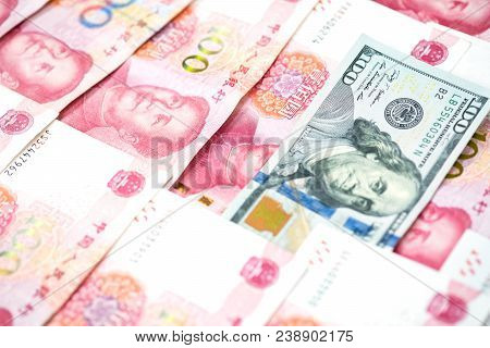 Different Concept With One Hundred Us Dollar Bill In Pile Of One Hundred Chinese Yuan Bills, Currenc