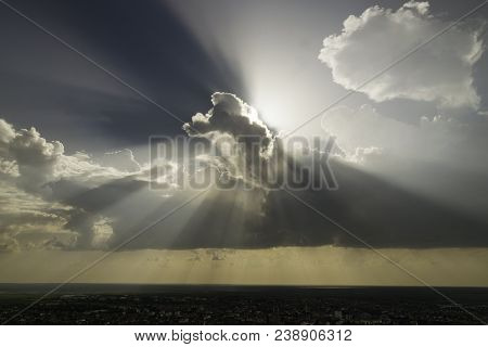 Sun Rays And Clouds Landscape. Landscape With Clouds Over Small Town. Sun Rays Through Clouds Magica