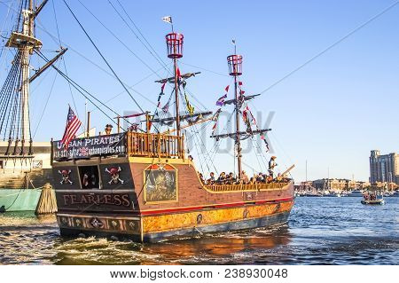 Baltimore - November 7; Pirate Tourist Ship With Tourists On Board Entertain People On November 7, 2