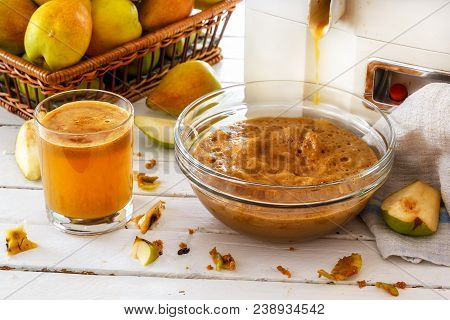 Home-made Pear Juice, Pressing Fruit. Group Of Pears And Sliced Pears On White Wooden Boards. Natura