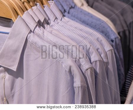 Men Shirt On Hanger. Official Men Wear In Shop. Shopping Mall Hanger Row. White Striped Uniform Shir