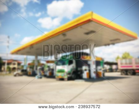 Blurred Image Of Gas Station With Car Refueling At Day. Defocused, Out Of Focus Gas Station And Conv