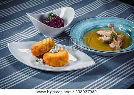 Set Of Three Dishes. Business Lunch Of Three Dishes. Three Dishes On White Plates On A Table With A