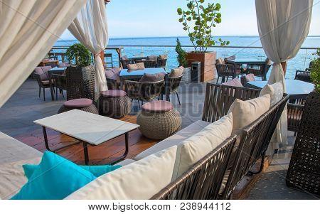 Recreation Area Near Sea. Seaview Restaurant On Shopping Mall Veranda. Seaside Restaurant Interior.