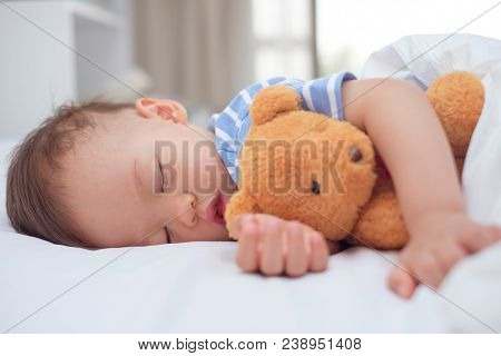 Cute Little Asian 18 Months / 1 Year Old Toddler Baby Boy Child Sleeping / Taking A Nap Under Blanke