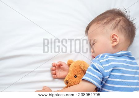Cute Asian 18 Months / 1 Year Old Toddler Boy Child Sleeping / Taking A Nap Under Blanket While Hugg