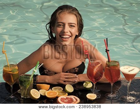 Summer Vacation And Party. Drink And Food. Cocktail And Sexy Girl In Pool. Swimming And Relax In Wat