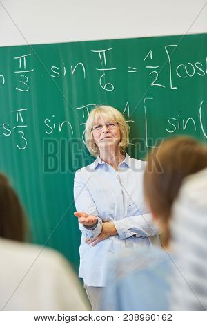 Successful universitiy math teacher teaching students with competence