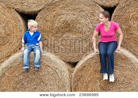 Mother and child on hay bales