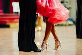 woman in pink gown and man black tailcoat latino dancing poster