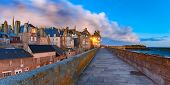 Night panoramic view of beautiful walled city Intra-Muros in Saint-Malo, also known as city corsaire, Brittany, France poster