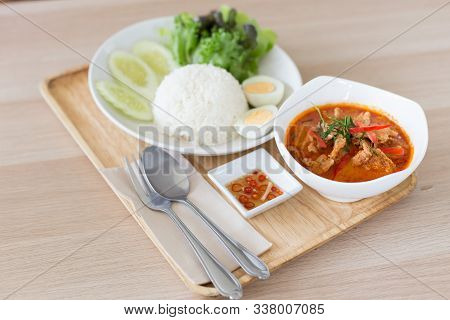 Popular Thai Cuisine Panang In A White Bowl And Rice On Wooden Tray
