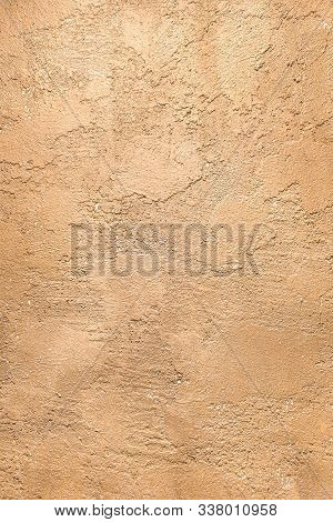 Golden Texture Wall Of Decorative Heterogeneous Plaster. Gold - Brown Surface Background Close-up