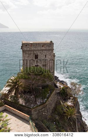 Monterosso, Italy - April 2 2018: The View Of Aurora Tower Of Monterosso Castle With Sea On Backgrou