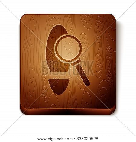 Brown Magnifying Glass With Footsteps Icon Isolated On White Background. Detective Is Investigating.