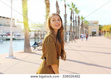 Fashion Girl Walking In Alicante Promenade, Spain. Young Woman Enjoying Walk In Mediterranean Seasid