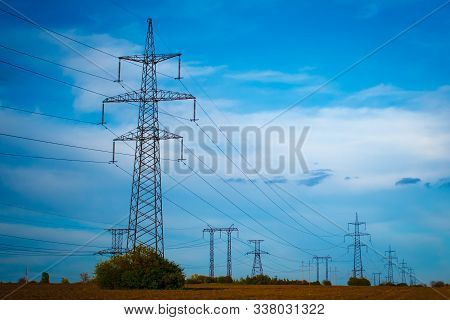 Group Silhouette Of Transmission Towers (power Tower, Electricity Pylon, Steel Lattice Tower) At Twi