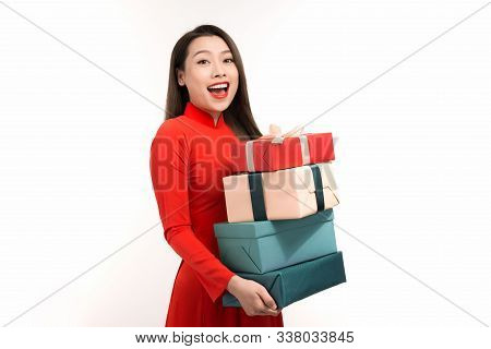 Portrait Of Happy Asian Woman Holding On Gift Box While Celebrating Lunar New Year