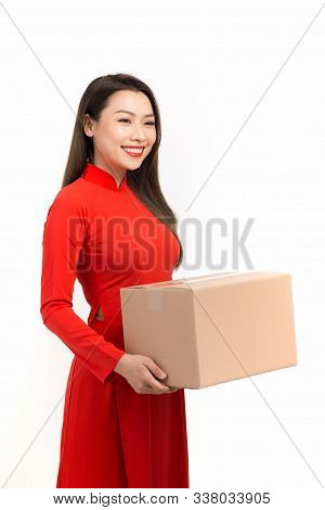 Asian Girl With Vietnamese Traditional Dress Holding Gift Box, Lunar New Year Greetings