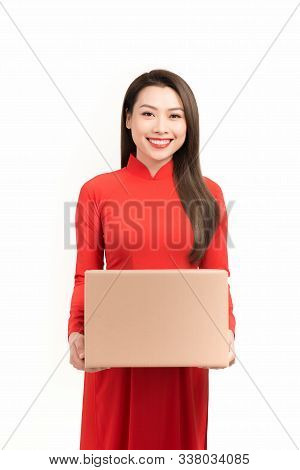 Asian Woman With Ao Dai And Hold Big Gift Box