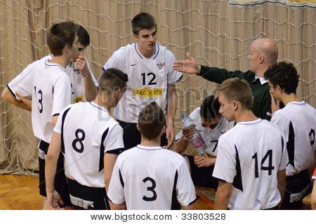 KAPOSVAR, HUNGARY - MAY 18: Szolnok players listening to trainer at the final of the hungarian junior championship (Dag yellow vs. Szolnok white) , May 18, 2012 in Kaposvar, Hungary