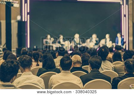 Rear View Of Asian Audience Joining And Listening Group Of Speaker Talking On The Stage In The Semin