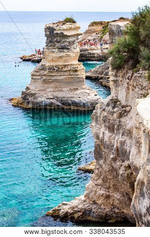 Torre Sant Andrea, Puglia, Italy - September 09, 2019: People Diving From The Cliff, Sunbathing, Swi
