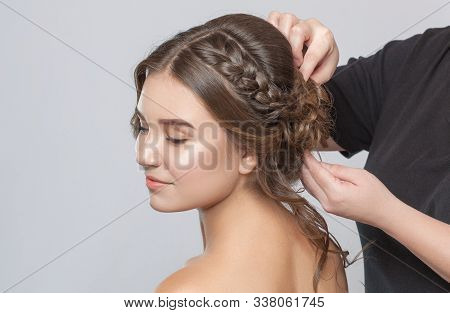 Portrait Of A Beautiful Sensual Light Brown Haired Woman With A Wedding Hairstyle In A Beauty Salon.