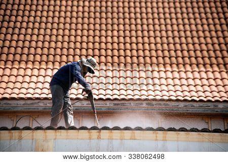 Nakornphathom,thailand - December 5,2019 : Unidentified Roof Top Worker With Professional Equipment