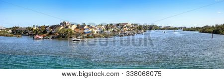 Loxahatchee River With The Jupiter Inlet Lighthouse In The Background