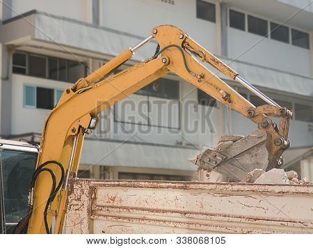 Bulldozer Removes The Debris From Demolition On The Construction Site