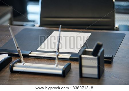 Modern Office Work Place In Large Corporation. Comfortable Work Table With Stationery, Leather Compu