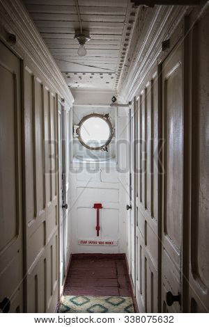 Passageway To A Porthole On An Old Passenger Vessel The S.s. Keewatin, A Victorian Era Liner That Sa