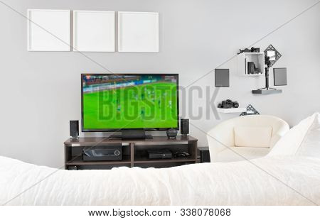 Cozy Interior Of Living Room With Television, Tv Watching Football, Soccer Match On Television At Ho