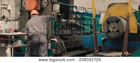 Manufacturing Worker Operating Machine With A Control Panel In Metal Industry. Industrial Machine Op