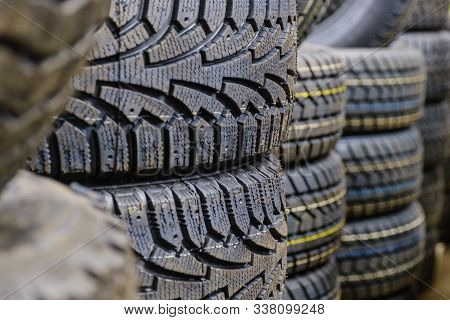 Row Of New Car Tires At Tire Store. Closeup Tires In Store For Sale.