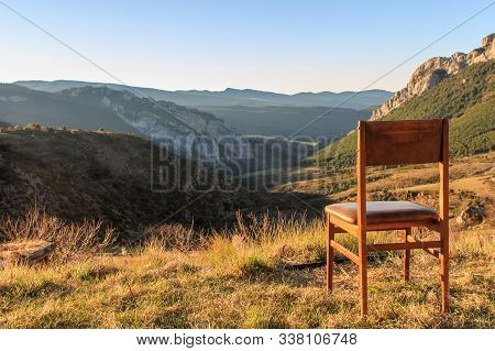 Wooden Chair On Top Of The Mountain With Mountain Views