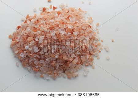 Heap Of Himalayan Salt Scattered On White Table