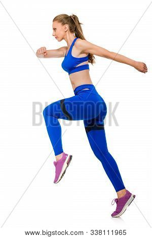 Side View Photo Of Fit Healthy Woman Running On White Background